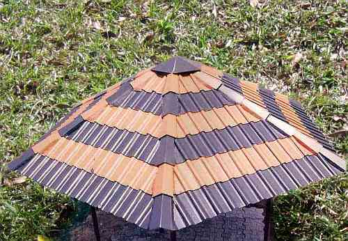 Gazebo with alternating orange and black tiles.